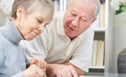 older couple looking at tax paperwork