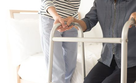 elderly person receiving assistance from caretaker