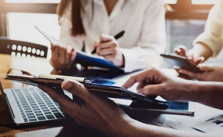 accountant reviewing financial charts