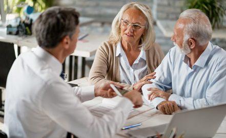 couple discuss estate plan with financial advisor
