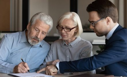 couple signing their asset protected trust